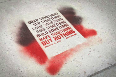 """Street graffiti from one of the first """"Buy Nothing"""" days in 2005. (Photo from Flickr by Resa & Krister)"""