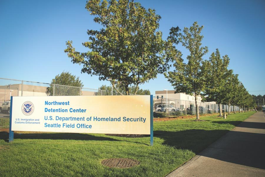 Outside the Northwest Detention Center in Tacoma, where immigrants facing deportation are incarcerated, and immigration cases are heard by the Justice Department's Executive Office of Immigration Review. (Photo by Damme Getachew)