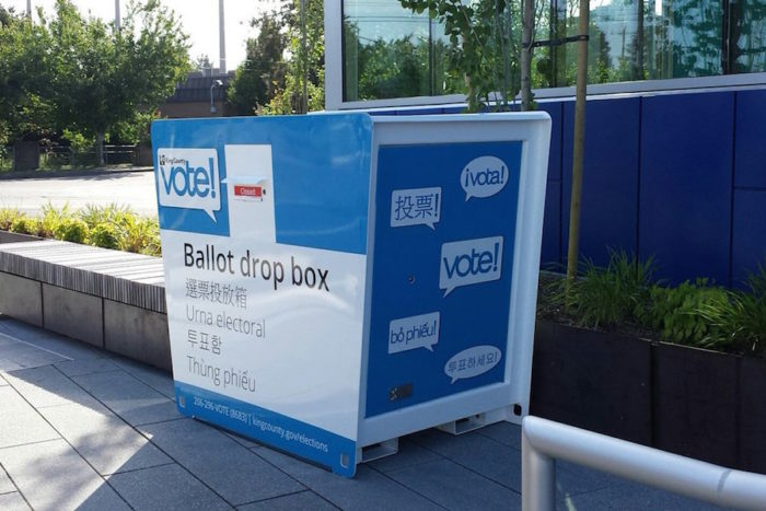"""One of the county's relatively new election boxes in Skyway. The box says """"vote"""" and """"ballot drop box"""" in Spanish, Chinese, English, Vietnamese and Korean —the languages that are available on county ballots. (Photo via King County Elections Twitter.)"""