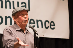 """Uncle Bob"" Santos speaks at the 2015 Governing for Racial Equity (GRE) Conference, which took place on June 11 – 12, 2015, at the Washington State Convention Center in Seattle. (Photo by Ned Ahrens for King County via Flickr. Photo has been cropped.)"