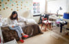 Sylvia Zhao, 22, sits in her newly rented room in a townhouse owned by a fellow Chinese international student in Lake City. (Photo by Katherine Jinyi Li)