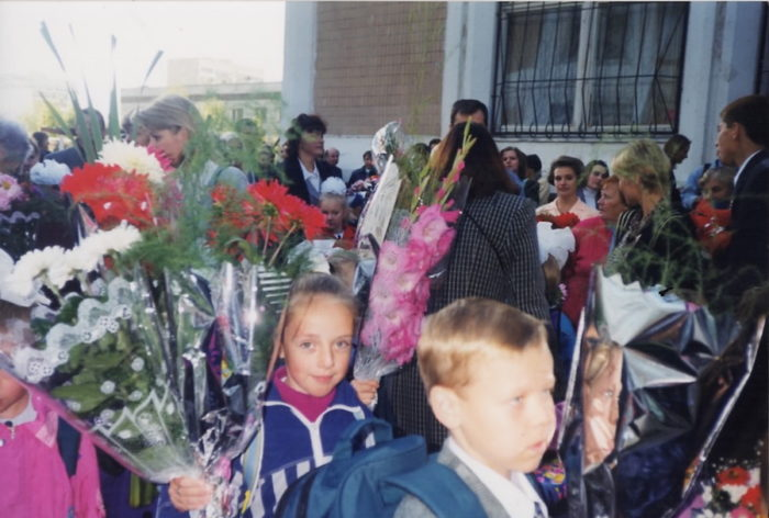 The author suffering through pictures on her very first day of school in Russia. (Photo courtesy of Daria Kroupoderova)