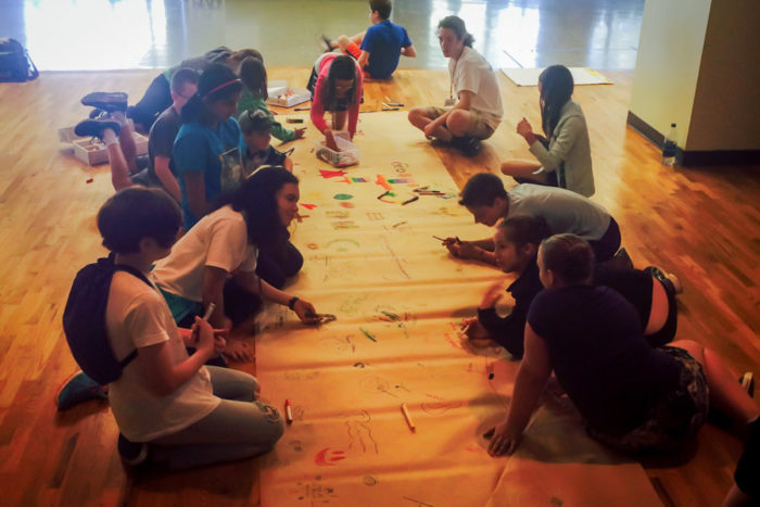 Working on a mural at the Kids4Peace camp. (Photo by Ahlaam Ibraahim)