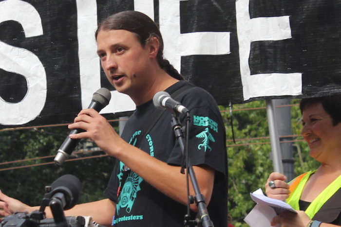 Matt Remle, who is Lakota, addresses the crowd. (Photo by Melissa Lin.)