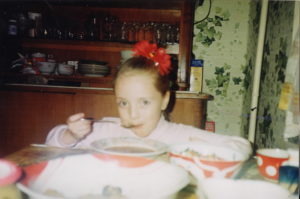 The author at age 7 in the kitchen of her apartment, eating lunch. (Photo courtesy of Daria Kroupoderova)