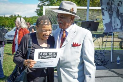 Pastor Patrinell Wright laughs with Blues singer Johnnie Moore, right, after the Wright and the Total Experience Gospel Choir performed at the Roots picnic. (Photo by Susan Fried)