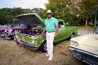 Capt. Ron stands by his classic muscle car, a 1973 Ford F100, part of the Old Riders car collection on display during the R.O.O.T.S. Picnic.