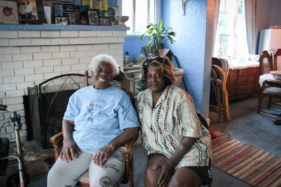 Dora Slack, left, sits in her living room Mary Hackey, a SAFE board member. (Photo by Alia Marsha)