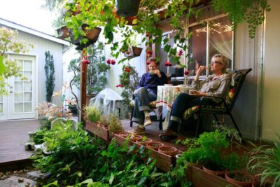 Jeff Holtzman and Jill Haas talk over coffee on the deck of their home at University Trailer Park in Seattle. The trailer park, one of the last in Seattle, will soon be closing for redevelopment. (Photo by Erika Schultz / The Seattle Times)