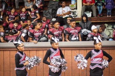 The Renton Rangers Junior team and cheerleaders watch the Seniors play against the Beacon Hill Cowboys in West Seattle on August 27th.