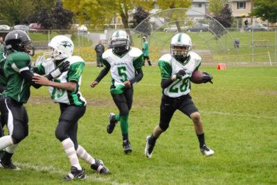 Rainier Raven Senior James Duncan, 13, follows some blockers down field in a game against rival, the Rainier Eagles in 2011.