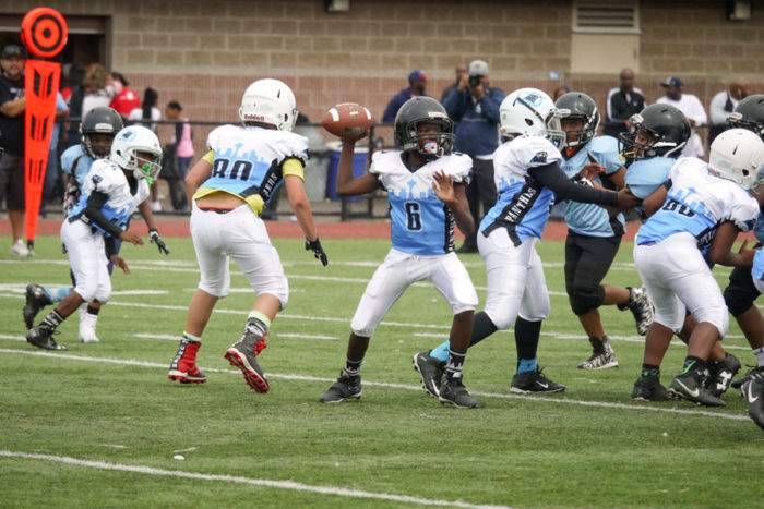 Johnny Rogers, quarterback for the CD Panthers 89er's, prepares to throw a pass against the SeaTac Sharks