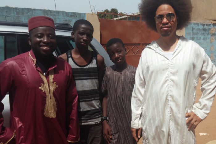 Malakhi Kaine of Africatown Center in Seattle and Demba Hydara stand with two former Seattle Public School Students that moved to The Gambia over the summer. (Photo courtesy Malakhi Kaine.)