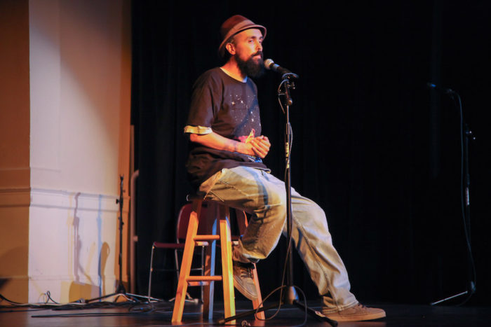 "Gabriel Teodros performs at the Seattle Globalist's ""Stories of Finding Home"" event at the Rainier Arts Center. (Photo by Alex Stonehill)"