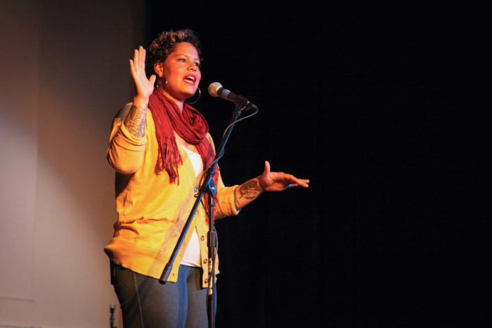"Artist Nikkita Oliver onstage at ""Stories of Finding Home,"" a Seattle Globalist event at the Rainier Arts Center. (Photo by Alex Stonehill)"