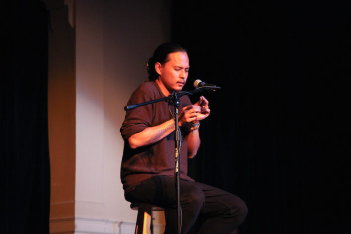 "Roldy Ablao onstage at the Rainier Arts Center for the Seattle Globalist's ""Stories of Finding Home."" (Photo by Alex Stonehill.)"