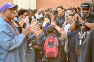 Dozens of black professionals and community leaders came to Leschi Elementary School on Friday to greet students on their way to class. (Photo by Sharon H. Chang)