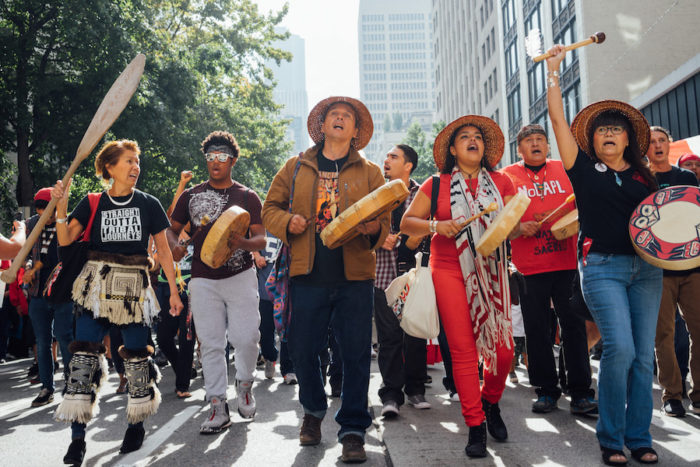 The march in support of the Standing Rock Sioux and against the Dakota Access Pipeline started at Seattle City Hall and ended at Westlake Park. (Photo by Chloe Collyer)