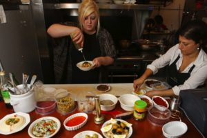 """Yalla,"" a middle-eastern food popup restaurant in the Central District has chefs Taylor Cheney, left, and Pinar Ozhal, right, busy in the kitchen of The Atlantic restaurant, Monday, Oct. 3, 2016, in Seattle. The Middle Eastern pop-up focuses on conflict region food, with tonight emphasizing dishes from Kurdistan. (Photo by Ken Lambert for The Seattle Times.)"