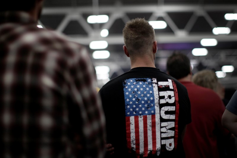 A man stands in the audience before Republican presidential nominee Donald Trump appears at a campaign rally in Manheim, Pennsylvania on October 1st. (Photo from Reuters / Mike Segar)