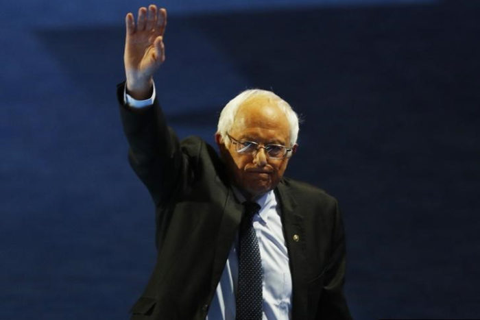 Senator Bernie Sanders leaving the stage after addressing the Democratic National Convention. (Photo from Reuters / Scott Audette)