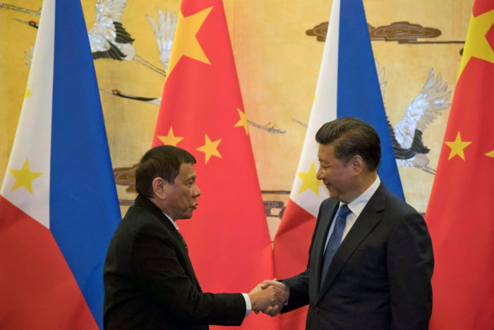 Philippine President Rodrigo Duterte (L) and Chinese President Xi Jinping shake hands after a signing ceremony held in Beijing, China October 20, 2016. (Photo by Ng Han Guan for Reuters/Pool)