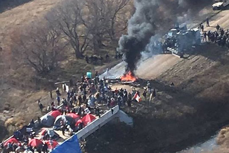 Protestors against the Dakota Access Pipeline stand-off with police in this aerial photo of Highway 1806 and County Road 134 near the town of Cannon Ball, North Dakota, U.S., October 27, 2016. Photo by Morton County Sheriff's Office via Reuters.