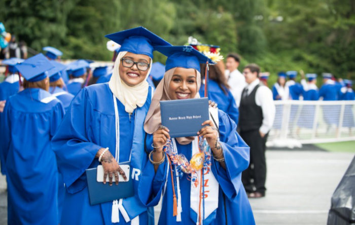 The author, right, and her friend Ifrah Abshir, at graduation from Rainier Beach High School last spring. (Courtesy photo)