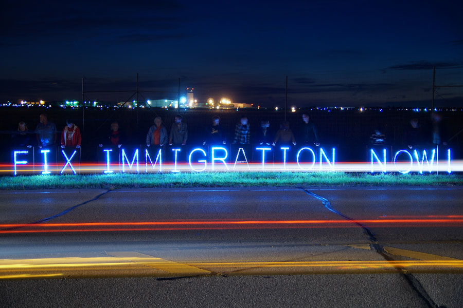 A highway-side protest calling for immigration reform in Kenosha County, Wisconsin. (Photo from Flickr by Joe Brusky)