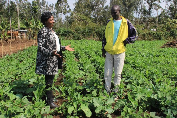 Rosemary Muthomi visits a farmer. (Photo courtesy Meru Greens.)