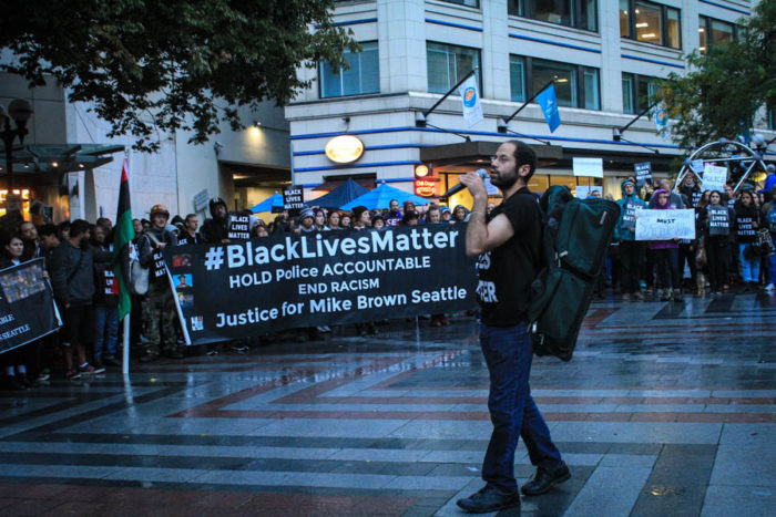 Activist Miles Partman speaks to the crowd at Westlake Park on Saturday Oct. 1. (Photo by Melissa Lin.)