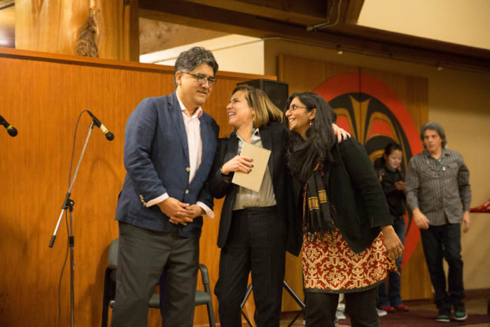 Author Sherman Alexie (left) and Seattle City Council members Debora Juarez and Kshama Sawant at the Indigenous People's Day celebration at Daybreak Star Indian Cultural Center. (Photo by Alex Garland)