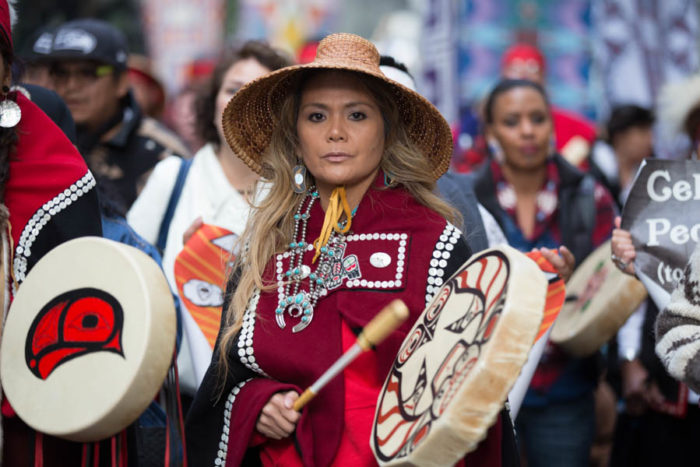 Pamela Kaajeesta Dalton marches in Seattle to celebrate the city's thirdIndegenous People's Day. (Photo by Alex Garland)