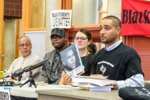 (Right) Garfield High School teacher Jesse Hagopian talks about Black Lives Matter curriculum at a press conference. Other teachers include (left to right) Rogelio Rigor, Donte Felder and Sarah Arvey. (Photo by Venice Buhain)