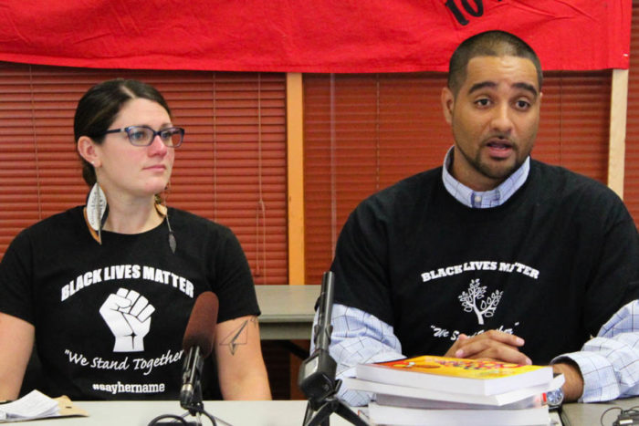 (Left to right) Seattle Public Schools teachers Sarah Arvey and Jesse Hagopian at an announcement that teachers and other staff districtwide plan to wear Black Lives Matter shirts, similar to the ones that they are wearing, as a show of support for students of color. (Photo by Venice Buhain)
