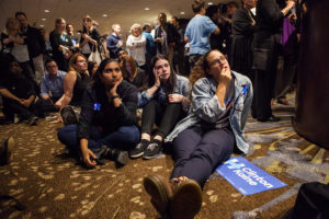 (L-R) University of Washington students Madhavi Kuthanur, Melissa Diamond and Olivia Corti react as polling results move in the favor of Republican Presidential nominee, Donald Trump. (Photo by Jovelle Tamayo.)