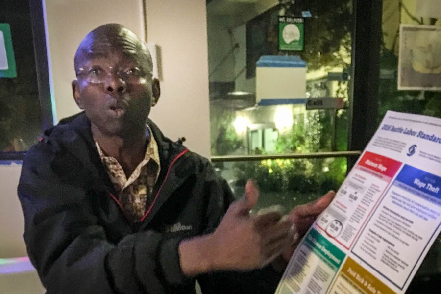 Felix Ngoussou, a Seattle Central District business owner and an immigrant from Chad, supports Initiative 1433, but acknowledges the initiative puts a burden on small businesses. (Photo by Lee Nacozy.)
