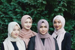 "Afiqah Amil's clothing line campaign of ""Amil"" Fall collection with displaying different colors worn by women from various backgrounds."