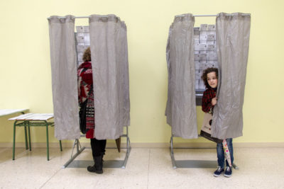A girl goes with her mother to vote for the European Parliament elections in 2014. Most young Europeans we asked said they're watching the U.S. election closely and say it will impact their lives. (Photo from Flickr by Enrique Balenzategui Arbizu)