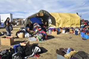 People exiting Sacred Stone Camp often leave their winter coats, shoes and other items behind for people who plan to remain there. (Photo by Natalia Aldana for GPJ Americas)