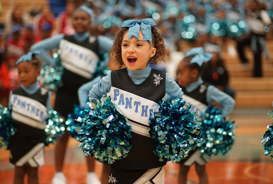 A Mini Central District Panther Cheerleader shows some spirit during the Cheer Competition. (Photo by Susan Fried)