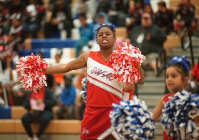 A Southwest Athletic Club cheerleader performs at the competition. (Photo by Susan Fried)