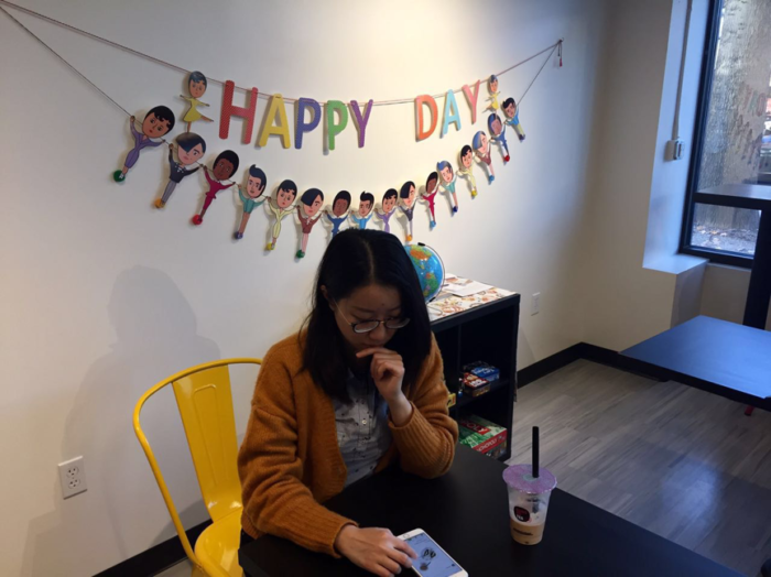 Yanqing Lou is looking for a new recipe on her favorite cooking app while drinking milk tea. (Photo by Xinyi Xiong)