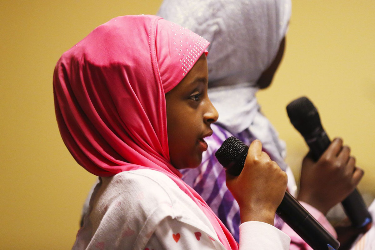 """Darartu Jamal, 9, speaks at the """"Election Reflection: Building Community Strength and Resilience"""" event on Nov. 21st. (Photo by Ken Lambert/The Seattle Times)"""