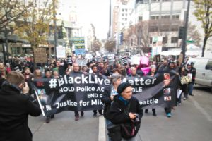 Marchers gathered in downtown Seattle for the third annual Black Friday demonstration. (Photo by Cliff Cawthon.)