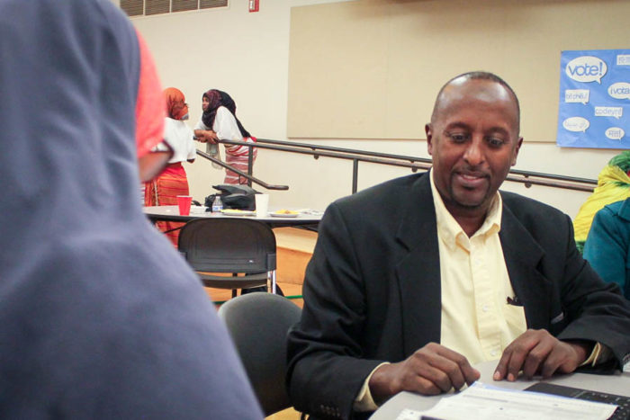 Adam Mohamed, a court interpreter, was available to help interpret ballots from English to Somali and Arabic at a multilingual ballot party at New Holly Gather Hall. (Photo by Venice Buhain.)