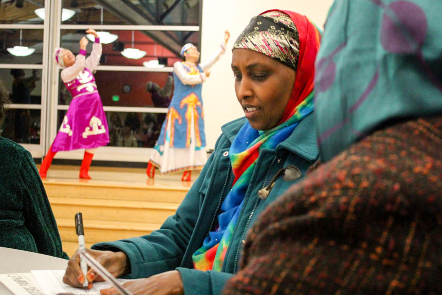 Habiba Hussein of Seattle votes at a multilingual ballot party at New Holly Gathering Hall on Friday evening. (Photo by Venice Buhain)