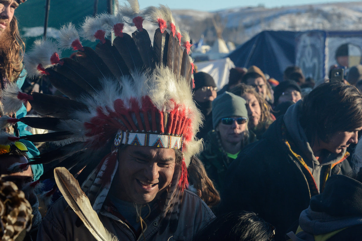 "People celebrate in Oceti Sakowin camp as ""water protectors"" continue to demonstrate against plans to pass the Dakota Access pipeline near the Standing Rock Indian Reservation, near Cannon Ball, North Dakota, U.S. December 4, 2016. Photo by Stephanie Keith for Reuters.)"