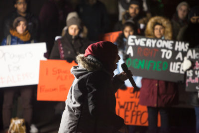 Malak Shalabi, 19, of Mill Creek, describes the horrors in Syria to the crowd of protestors. (Photo by Ramon Dompor)