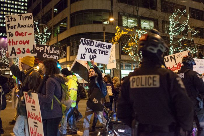 About 200 people marched through downtown Seattle to bring awareness to events in Syria on Friday evening. (Photo by Ramon Dompor)